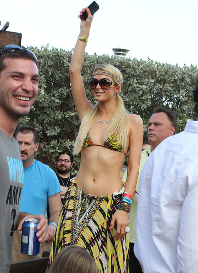 Paris Sports a Bikini Top in Miami While Her Reported Boyfriend DJs