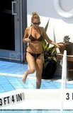 Nicole Richie in a purple bikini in Miami Beach.