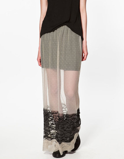 This sheer and lace skirt has such a special feel; equal parts edgy and femme — and perfect topped with a leather jacket.  Zara Long Tulle Swiss Dot Skirt ($70)