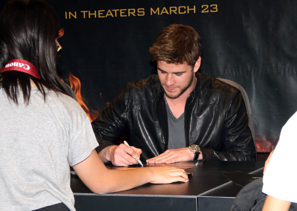 Liam Hemsworth signed autographs just hours before The Hunger Games hit theaters.