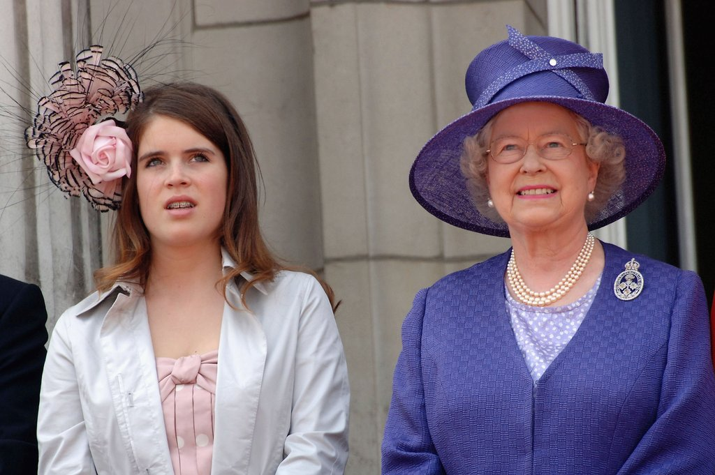 Princess Eugenie stands next to her grandmother in 2006.