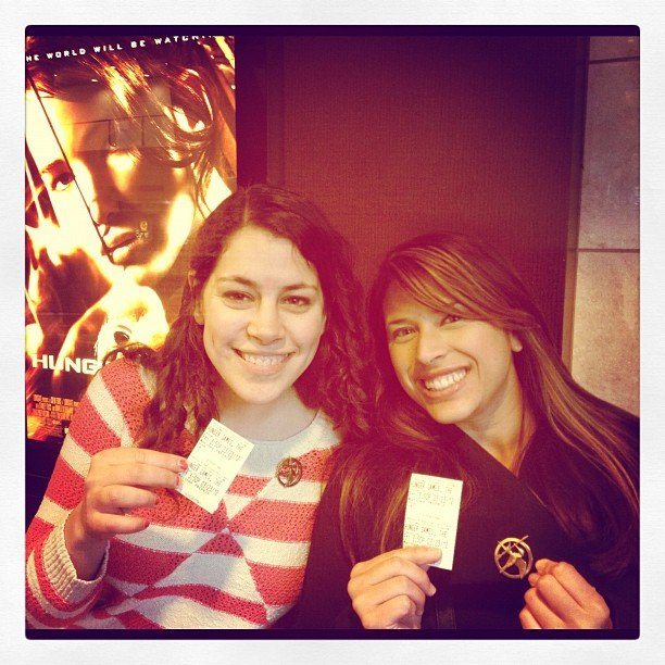 The Buzz team posed with our tickets and Mockingjay pins on opening day. Follow us at buzzsugar.
