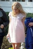 AnnaSophia Robb wore a light pink babydoll dress on the set of The Carrie Diaries.