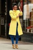 Freema Agyeman sported a bright yellow coat on the set of The Carrie Diaries.