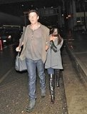Lea Michele held tight to Corey Monteith as they arrived at LAX.