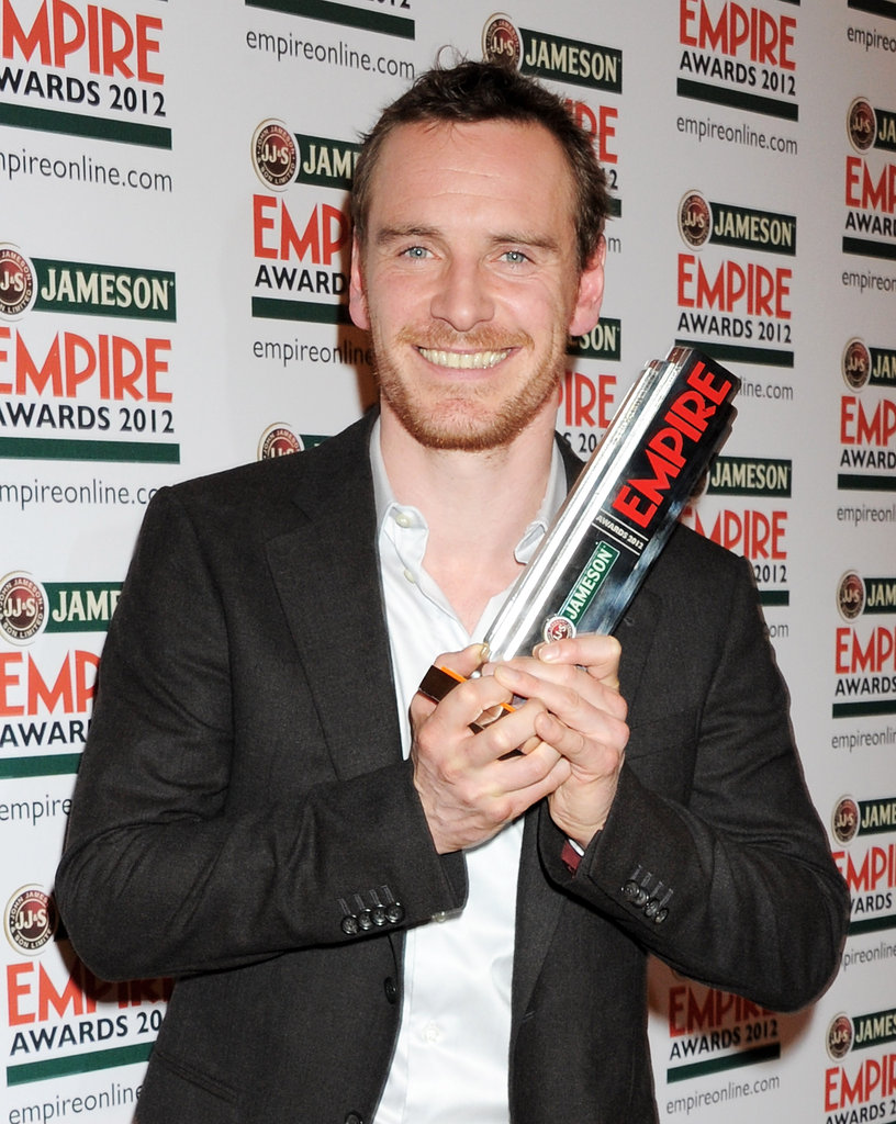 Michael Fassbender receives the hero award at the Jameson Empire Awards in London.