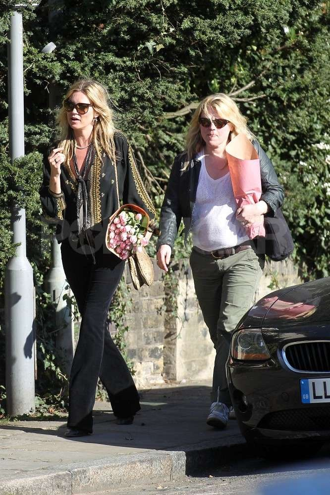 Kate Moss steps out with a friend near her home in Highgate, London.