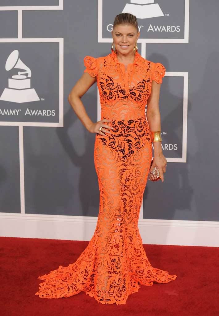 For the 2012 Grammys, Fergie hit the red carpet in a bright orange lace gown from Jean Paul Gaultier's Haute Couture collection. She tempered the sheerness of the dress with full-coverage, retro-cool underpinnings.