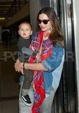 Miranda Kerr and her 1-year-old son, Flynn Bloom, arrived in LA Friday.