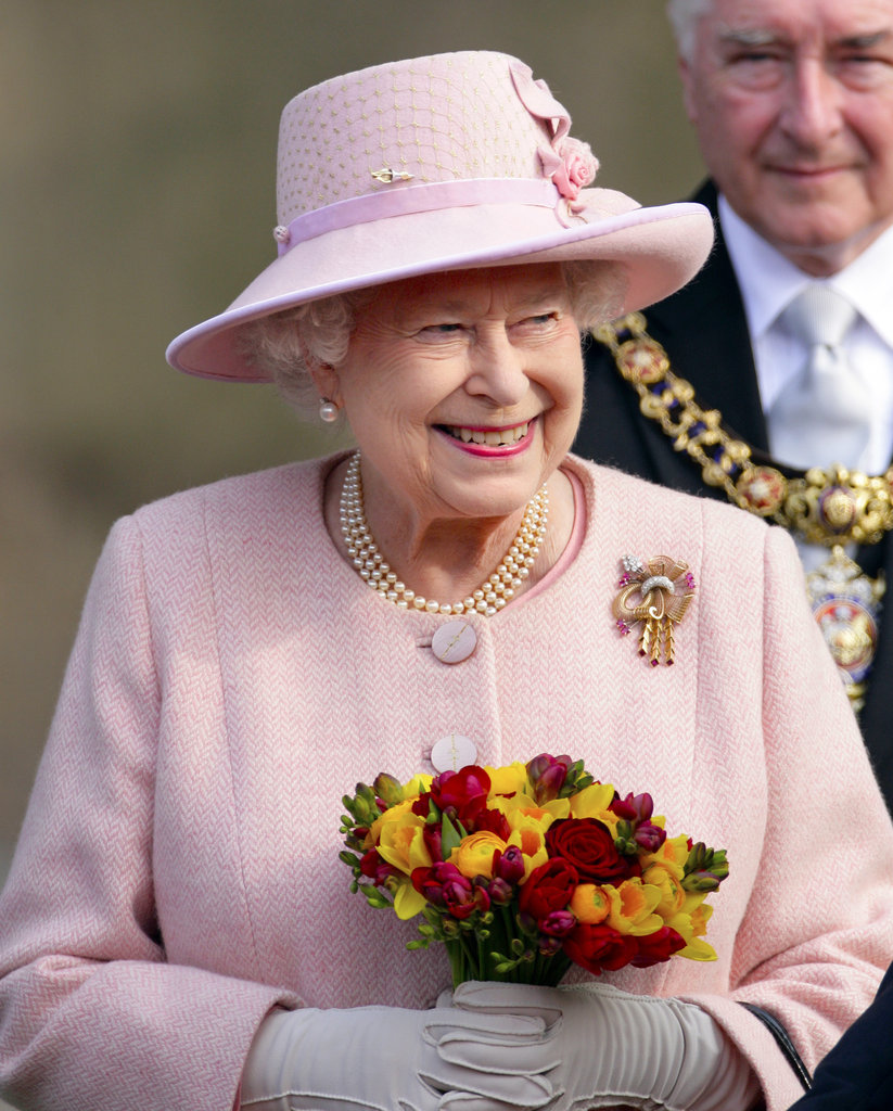 Queen Elizabeth II carried a posy of flowers as she left Manchester Town Hall after a visit as part of her Diamond Jubilee Tour.