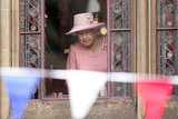 Queen Elizabeth II peered out of a window of Manchester Town Hall to view a Jubilee Garden.