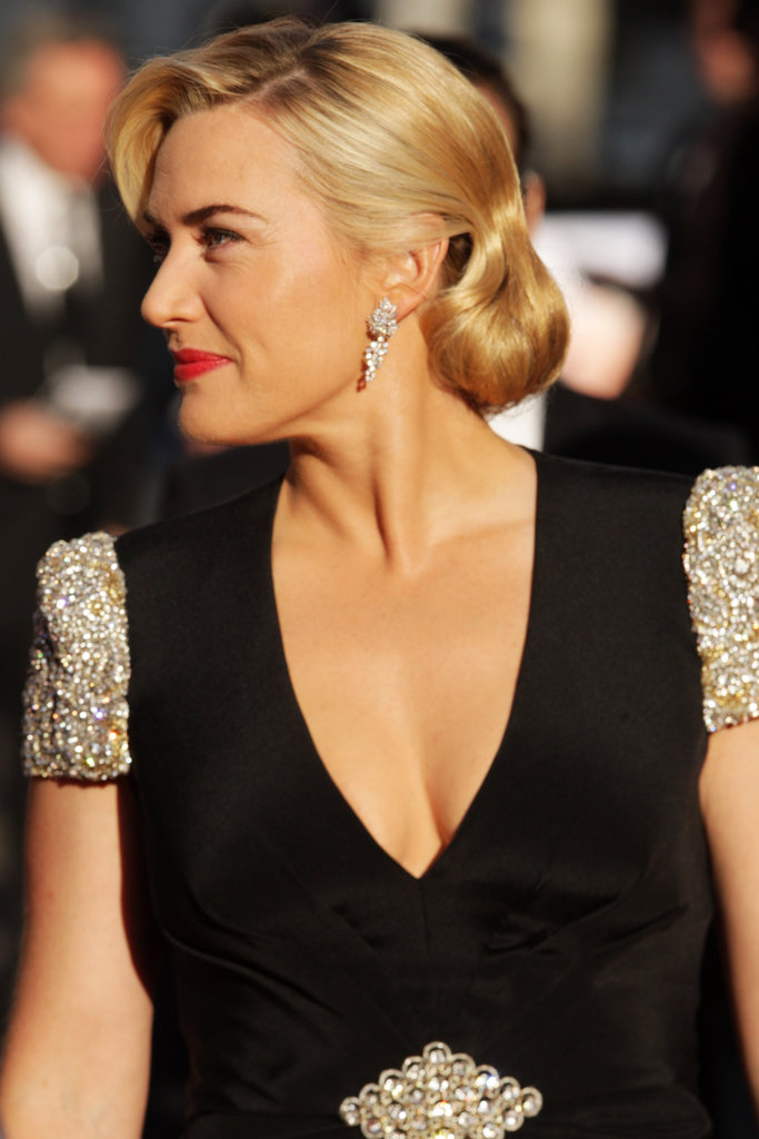 Kate Winslet sported bright red lipstick and a black v-neck gown for the Titanic 3D world premiere in London.