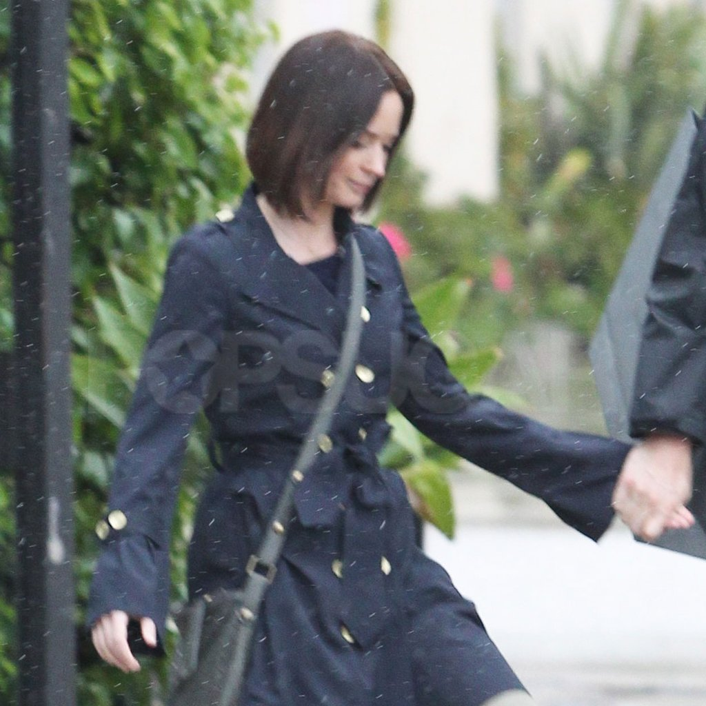 Emily Blunt wore a dark trench coat.