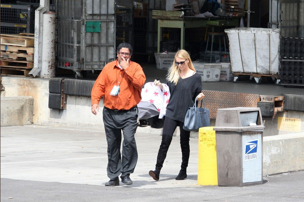 Charlize Theron left the post office with Jackson in LA.