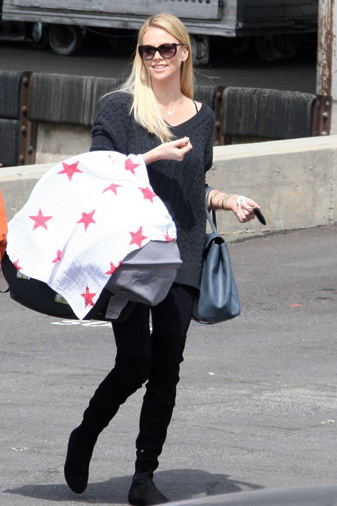 Charlize Theron carried Jackson covered by a blanket with stars.