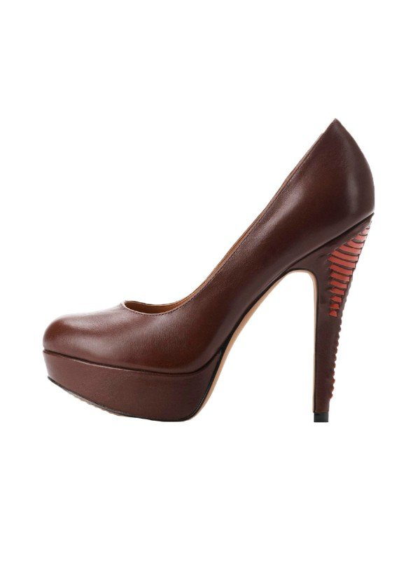 We love how the wooden heel gives these a cool, casual twist.  Vince Camuto Maari Pump ($129)