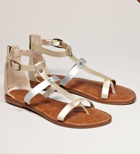 A pair of comfy sandals should be on the top of your list. Make sure they're slightly cushioned for maximum comfort. Sam Edelman for AEO Metallic Gladiator ($30)
