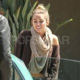 Miley Cyrus was wearing a scarf.