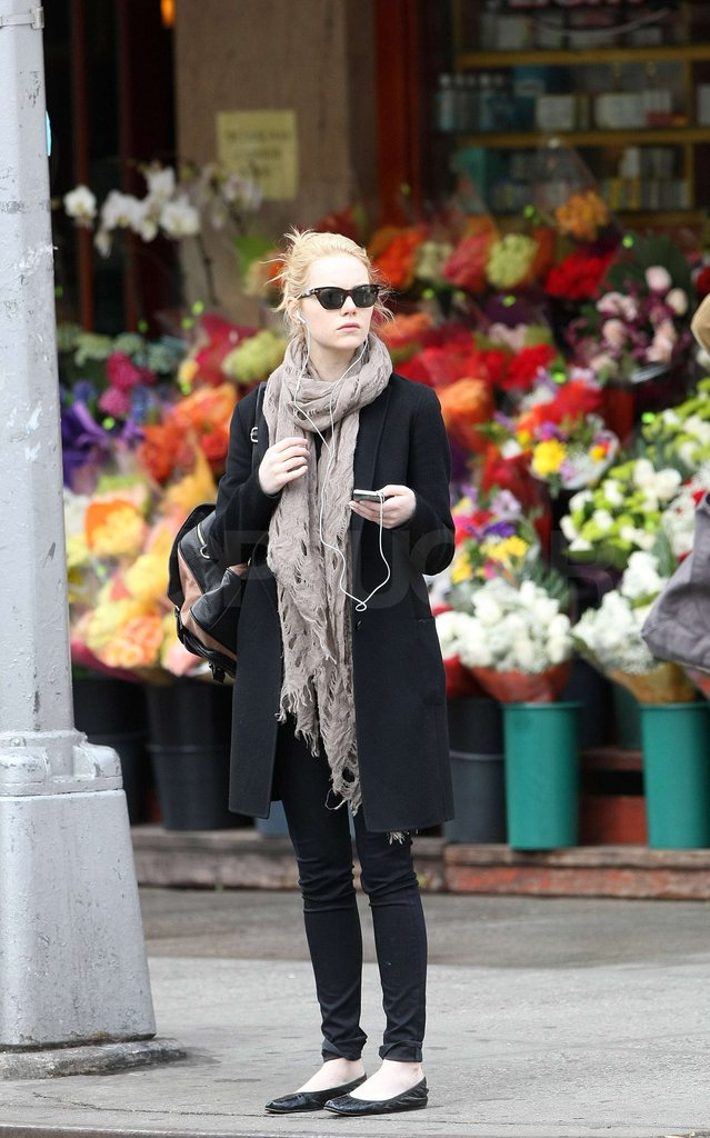 Emma Stone had her headphones in as she walked in NYC.