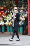 Emma Stone wore a long jacket and scarf while taking a stroll in NYC.