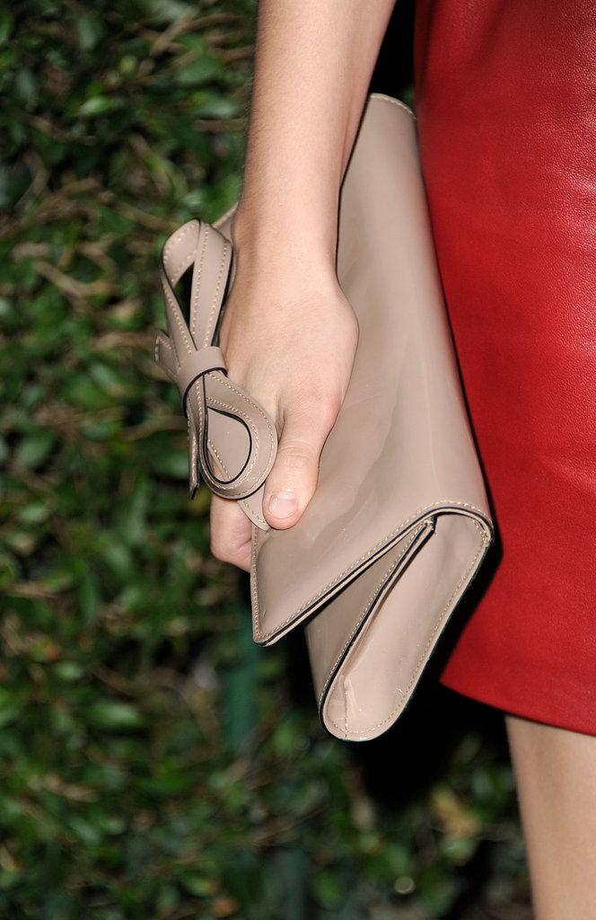 In hand, Teresa toted a Valentino bow-adorned clutch.