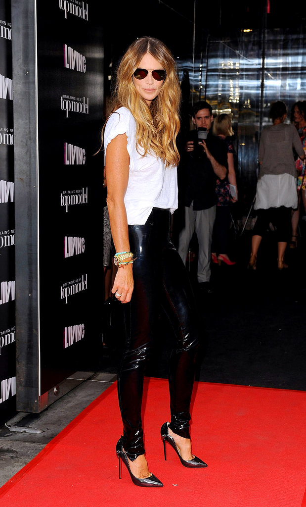 Rocking leather again. This time Elle dressed down her leather pants via a white tee and aviator sunglasses, then dressed them back up with pointy metallic pumps.                     Leggings by AG Adriano GoldschmiedPumps by Diane von Furstenberg