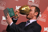 Michael Fassbender joked around with his best actor statue from the Venice Film Festival in September 2011.