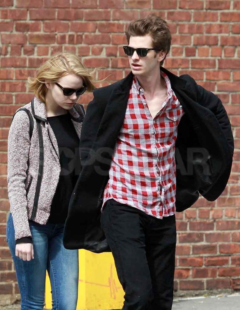 Andrew Garfield wore dark sunglasses.