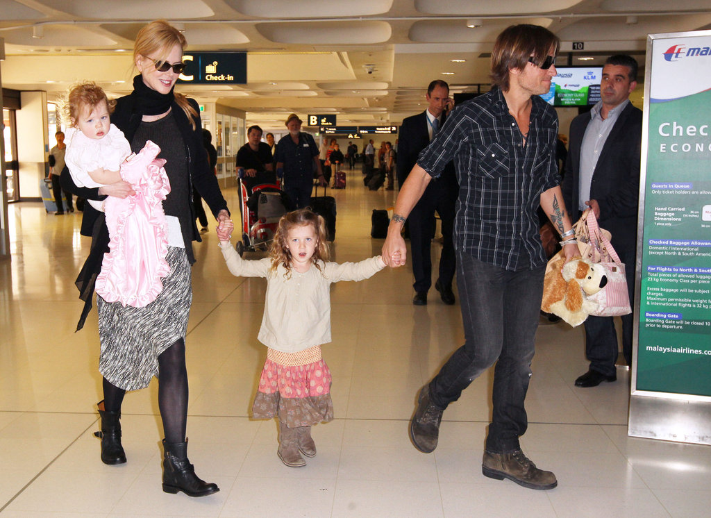 Nicole Kidman and Keith Urban made their way through the airport in Australia with daughters Faith and Sunday.
