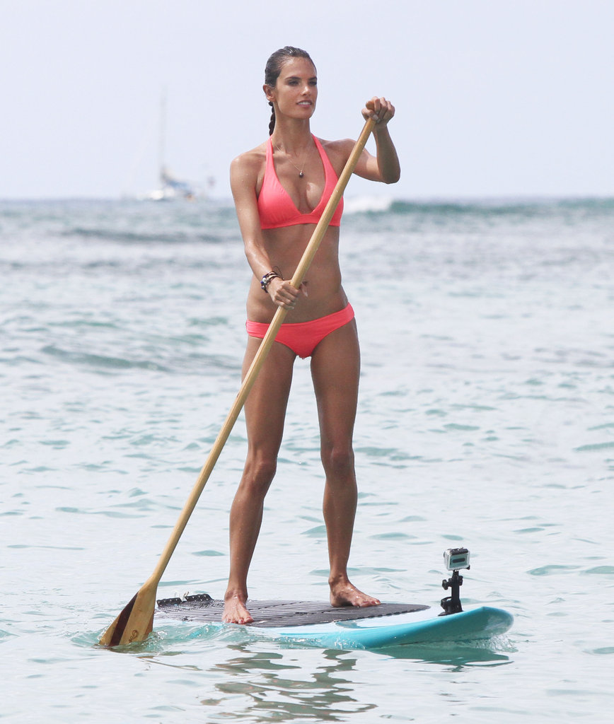 Alessandra Ambrosio wore a bright bikini while paddleboarding in Hawaii during October 2011.