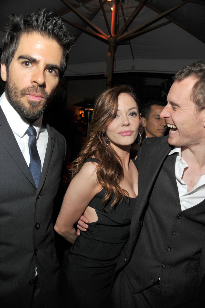 Michael Fassbender showed his fun-loving side at a GQ bash in LA with Rose McGowan and Eli Roth during November 2011.