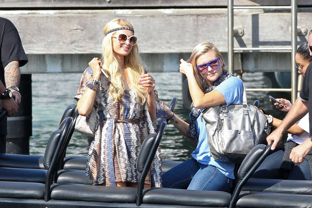 Paris Hilton took a boat ride in Sydney Harbor in Australia while wearing a blue bathing suit.