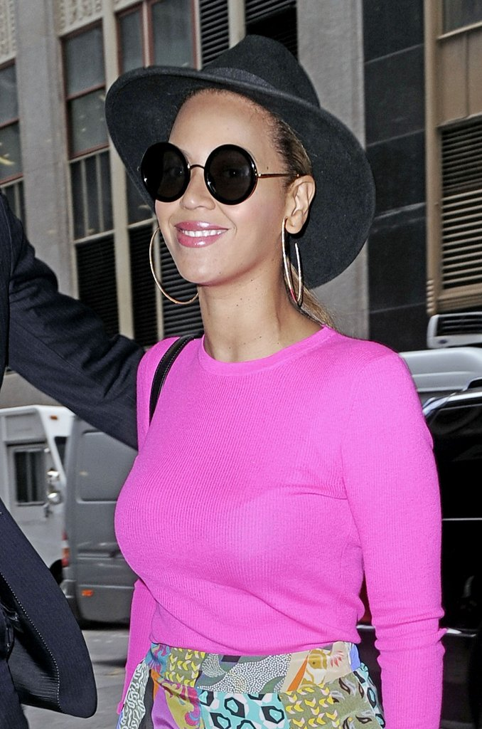 Beyoncé wore circle sunglasses and a bright pink top in NYC.
