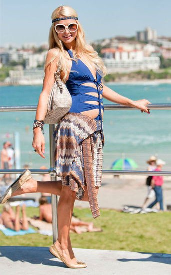 Paris Hilton enjoyed the view of Bondi Beach in a blue bathing suit with cutouts.