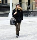 Elizabeth Olsen took a solo stroll through Manhattan.
