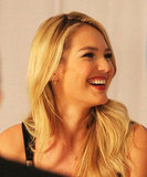 Candice Swanepoel smiled at a press event.