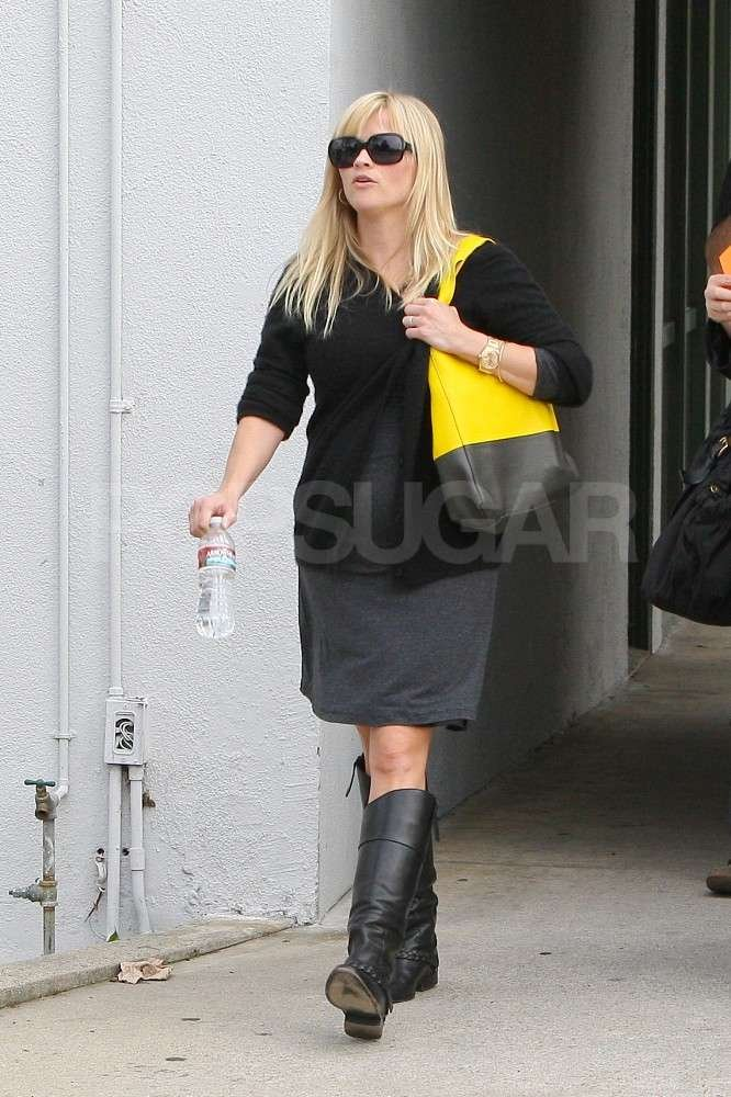 Reese Witherspoon wore an oversize black and yellow bag with a gray dress and sunglasses out in LA.