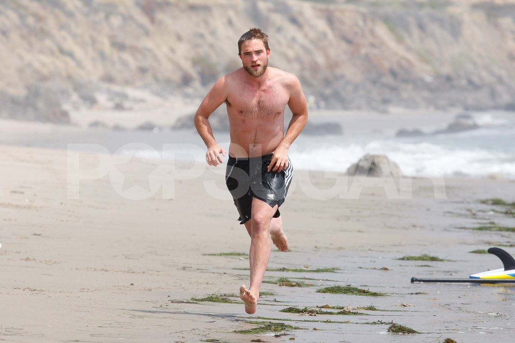 Robert Pattinson ran on the beach shirtless.