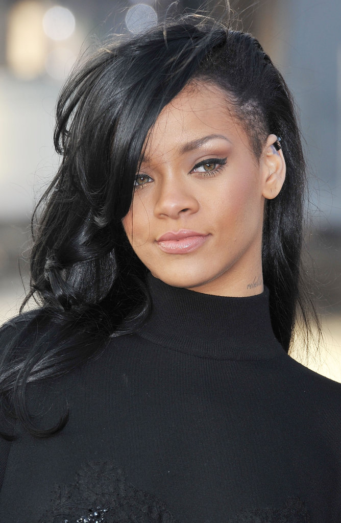 Rihanna sported new black hair at a Battleship photocall in Japan.