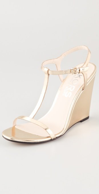 This soft metallic pair is perfect for warm-weather weddings and evening affairs. KORS Michael Kors Ruby T-Strap Wedge Sandals ($225)