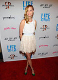 Ricki Noel Lander wore a white and ivory lace dress at the premiere of Life Happens.