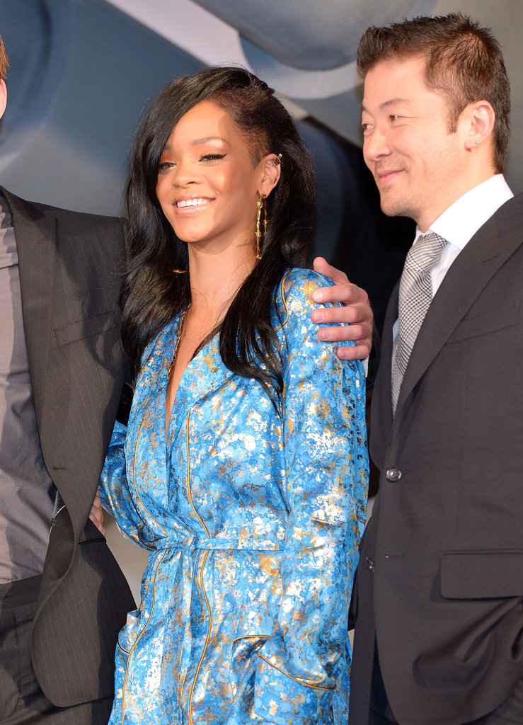 Rihanna was all smiles for photographers.