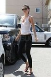 Miranda Kerr kept it casual in sandals as she went to the gym for a workout.