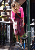 Sarah Jessica Parker matched hot pink and plaid in NYC.