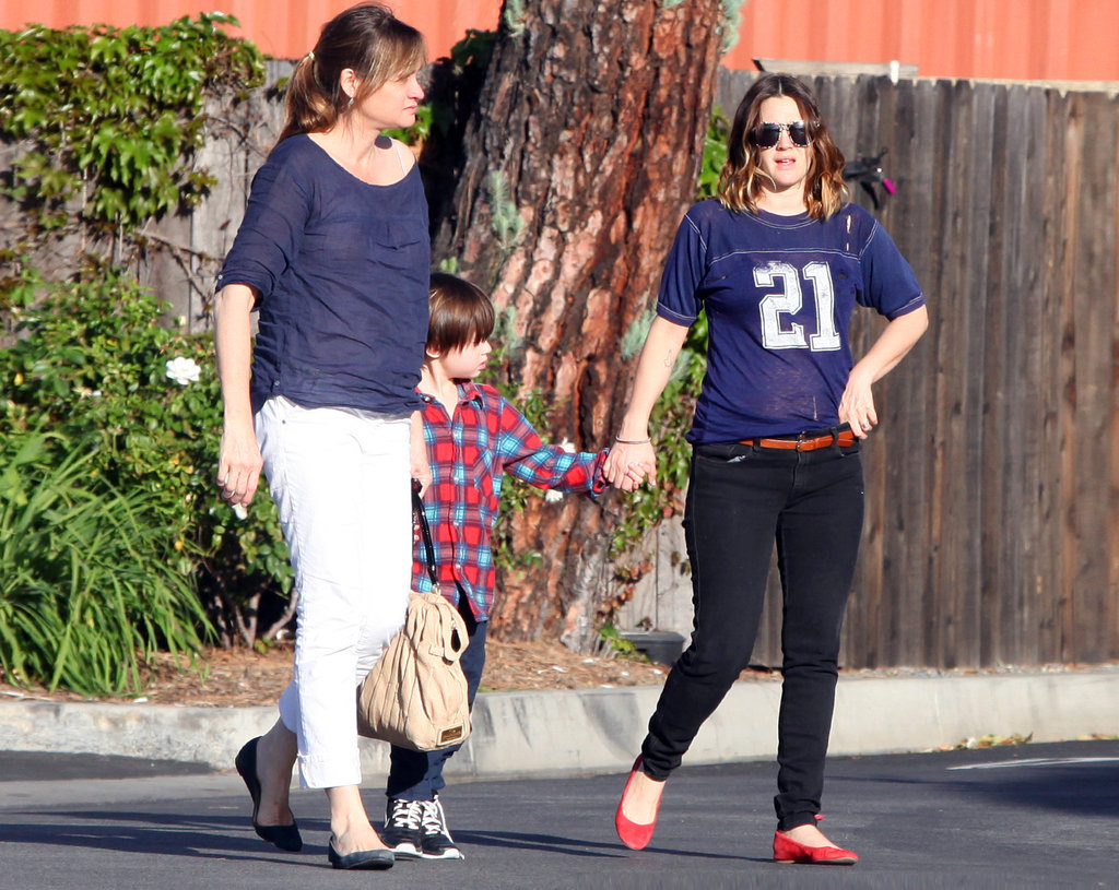 Drew Barrymore walked with two friends.