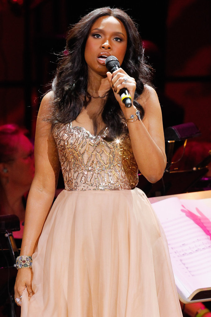 Jennifer Hudson gave a performance in a beautiful gold and pale pink dress at the Revlon Concert for the Rainforest Fund at Carnegie Hall in NYC.