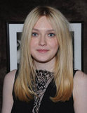 Dakota Fanning wore a black dress with a plunging lace neckline to a private Elie Saab dinner in NYC.