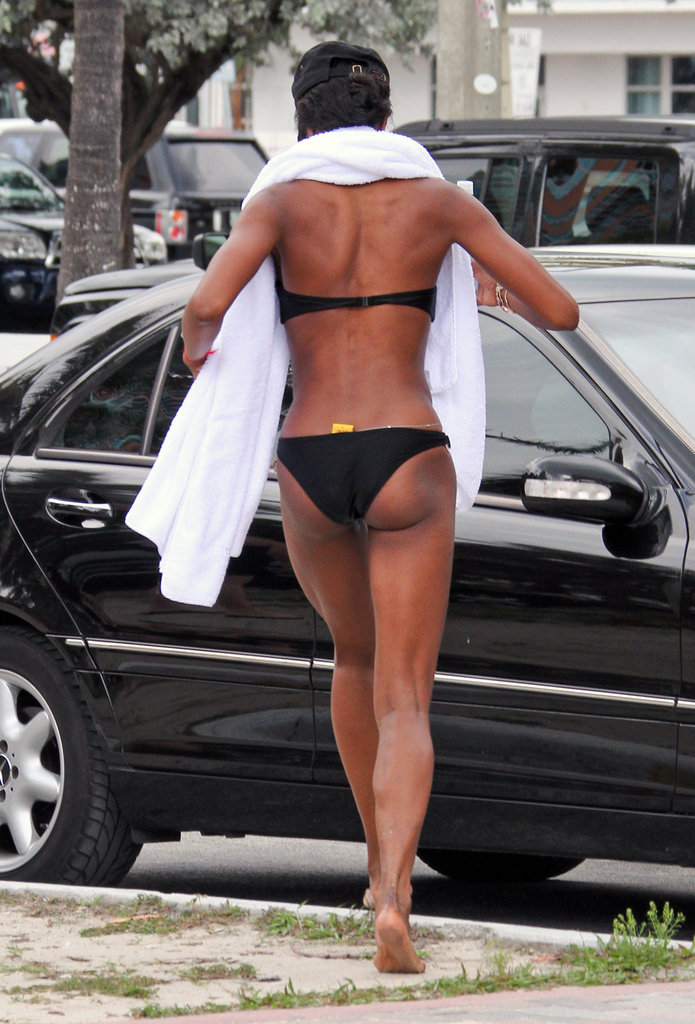 Naomi Campbell left the beach in a black bikini.