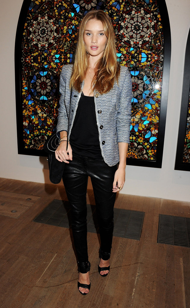 Rosie Huntington-Whiteley checked out the Damien Hirst exhibit in London in a tweedy Theyskens' Theory jacket and leather pants.