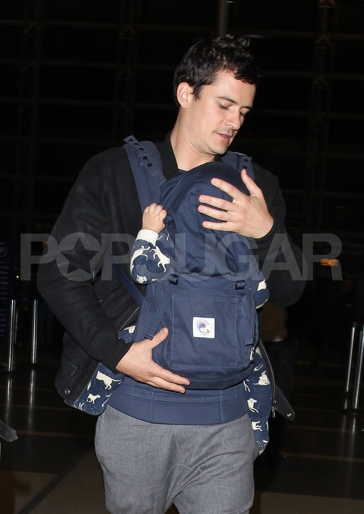 Orlando Bloom walked with son Flynn Bloom at LAX.